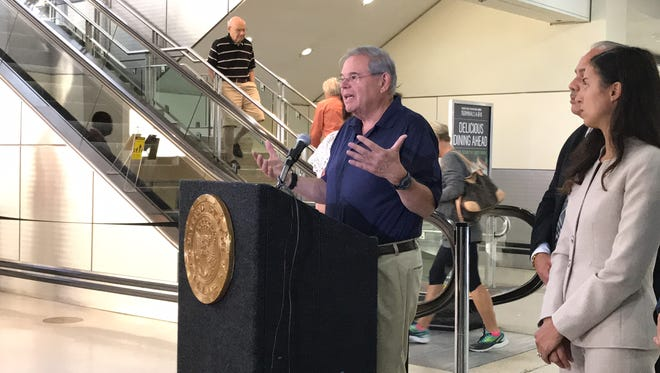U.S. Sen. Bob Menendez speaking with reporters at Newark Liberty International Airport before heading to Puerto Rico to assess the damage and relief needs following Hurricane Maria.
