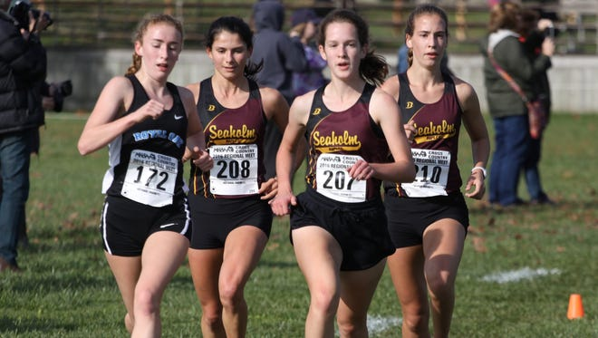 """Seaholm's """"big three"""" of Audrey Ladd (207), Rachel McCardell (208) and Emily Rooney (210) swept the top three spots to lead Seaholm to the Division 1 regional title. The Royal Oak runner is Grace Cutler (172), who finished fourth."""