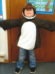 Gage tests out a killdeer costume at St. John Lutheran