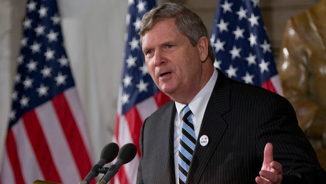 Agriculture Secretary Tom Vilsack gestures as he speaks on Capitol Hill in Washington, Tuesday, March 25, 2014, during a ceremony to dedicate a statue of the late Dr. Norman E. Borlaug in National Statuary Hall of the United States Capitol. (AP Photo/Carolyn Kaster) ORG XMIT: DCCK108