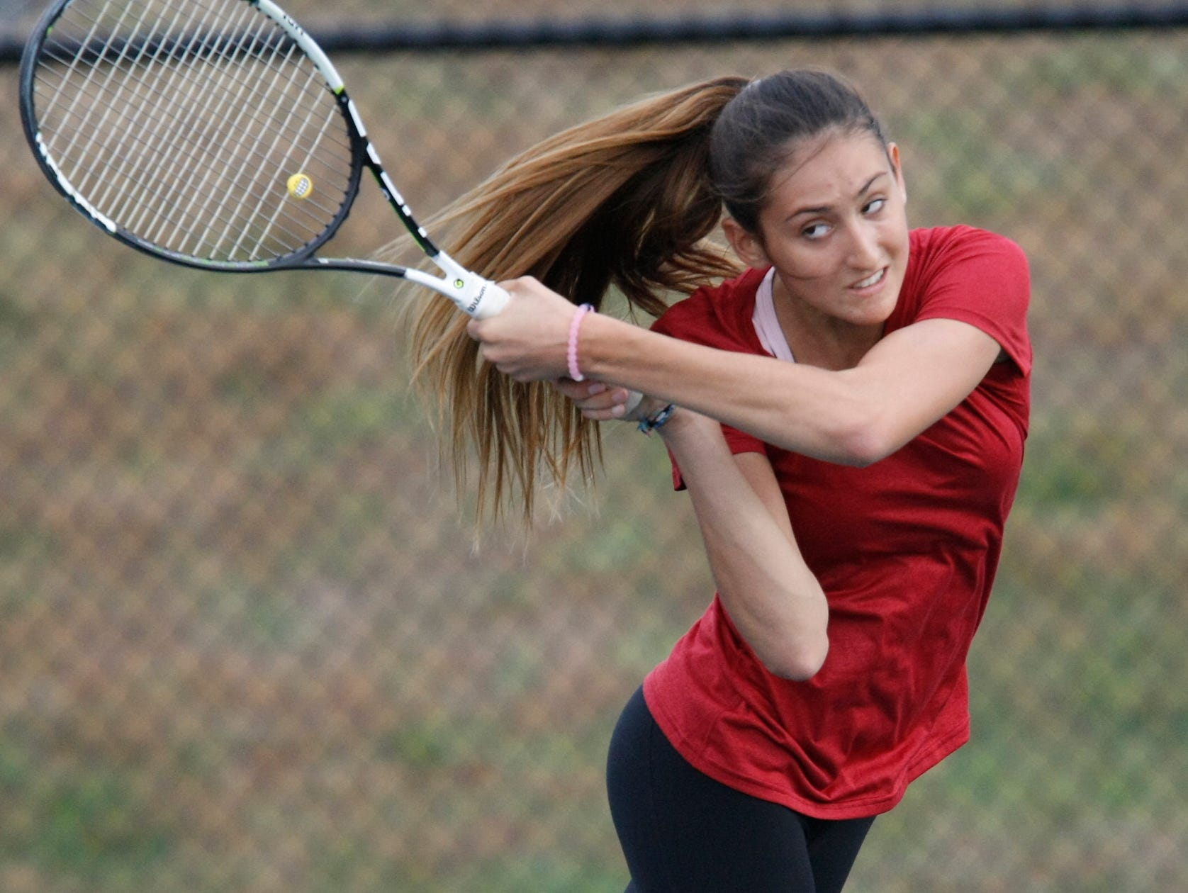 Arlington's Maranda Sears returns a volley during the girls sectional tennis finals at Harrison High School on Thursday, Oct. 22, 2015.