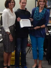 Sublimity School Student Body Treasurer Justus Bischoff (center) receives a Student Board award from School Principal Missy Riesterer (left) and board member Laura Wipper.