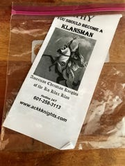 Fliers looking to recruit members for the Ku Klux Klan were found, contained in baggies, under the windshields of cars and on business doors Friday, Jan. 12, morning.