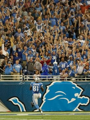 Detroit Lions fans are on their feet celebrating as Lions wide receiver Calvin Johnson breaks into the end zone all alone for the Lions first touchdown of the Monday Night Football game during first quarter action against the New York Giants at Ford Field, Monday, September 8, 2014. Diane Weiss/Detroit Free Press