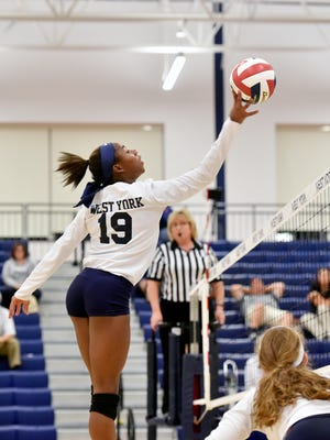 Tesia Thomas tips the ball in the second game in a YAIAA girls' volleyball match against Gettysburg Thursday, Sept. 7, 2017, at West York. Sisters Trinity Thomas, 16, and Tesia Thomas, 14, are different athletes in their own right, but each excels in her chosen discipline. Trinity Thomas is a gymnast on the U.S. senior national team who will attend Team USA's selection camp this month for a shot at a place on the squad for the world championships. Tesia Thomas is a standout three-season athlete for West York, where she plays volleyball, swims and is on the track and field team.