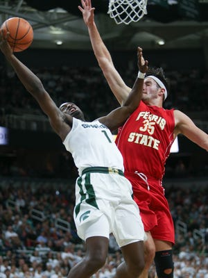 Joshua Langford misses a shot against Ferris State's Zach Hankins in the second half of the Spartans' 80-72 exhibition win over Ferris State on Thursday.