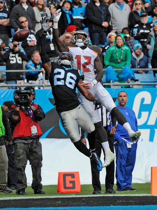 Tampa Bay Buccaneers' Chris Godwin (12) reaches in vain for a pass as Carolina Panthers' Daryl Worley (26) defends during the second half of an NFL football game in Charlotte, N.C., Sunday, Dec. 24, 2017. (AP Photo/Mike McCarn)