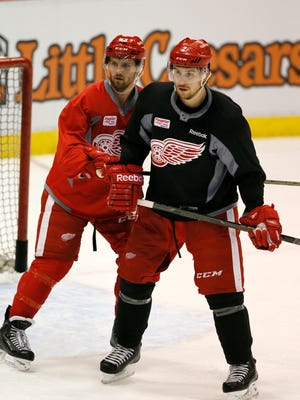 Detroit Red Wings forward Darren Helm, left, and defenseman Brendan Smith during practice for Game 3 of the first round of the playoffs against the Tampa Bay Lightning on April 20, 2015 in Detroit.