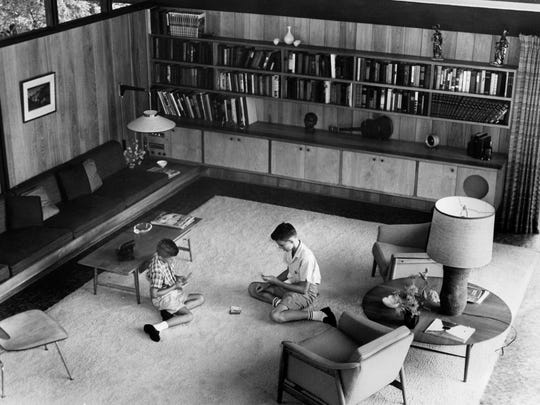 "The living room of Bruce McCarty's home in 1961. In the photo are sons Doug, 11, left, and Hayes, 15. ""I don't remember about when he was designing the house, but I remember the early experiences of living in the house,"" said Doug McCarty."