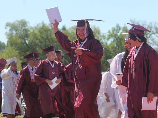 Chance Balatche holds his diploma high as he makes his way to the crowd. 52 students graduated from Tularosa High School on Saturday.