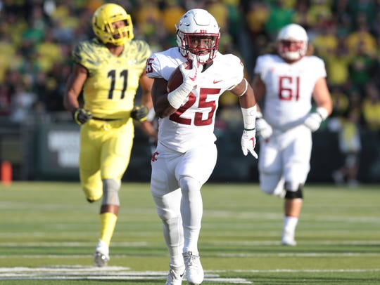 Washington State running back Jamal Morrow (25) runs