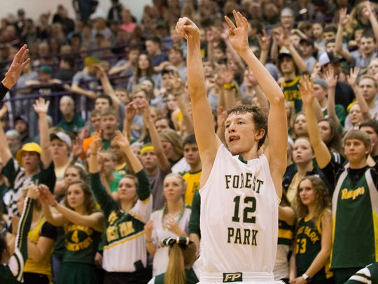 Forest Park's Isaac Uebelhor shot a three-pointer during