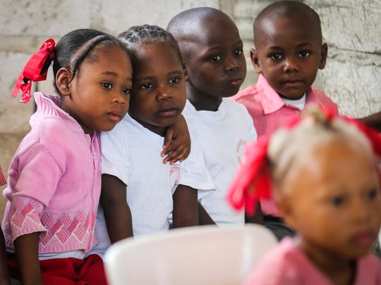 Kids wait in line for their medical check-ups March 6, 2018, at the David Steward Christian Institution for Boys and Girls in Onaville, Haiti.