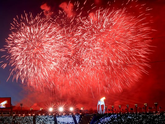 Fireworks detonate after the Olympic flame was lit during the opening ceremony of the 2018 Winter Olympics in Pyeongchang, South Korea, Friday, Feb. 9, 2018. (Sean Haffey/Pool Photo via AP)