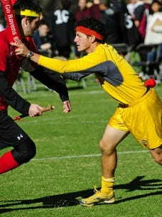 Competitors take part in a match of Quidditch.