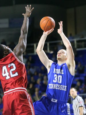 MTSU's Reggie Upshaw Jr. (30) goes up for a shot as he is guarded by WKU's Anton Waters (42). Upshaw shot 4 of 11 from the free throw line in the Blue Raiders' 78-72 loss.