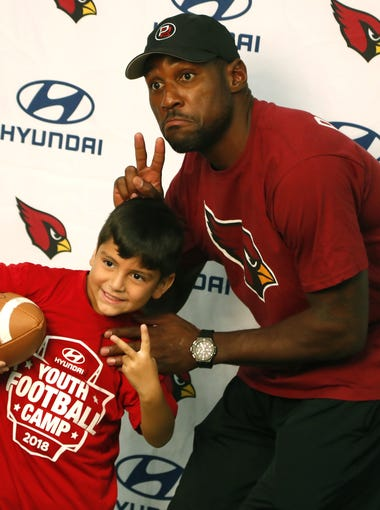 Cardinals Patrick Peterson takes a picture with Cannon Cabral on his birthday during the Hyundai Youth Football Camp at Arizona Sports Complex in Peoria, Ariz. on July 2, 2018.