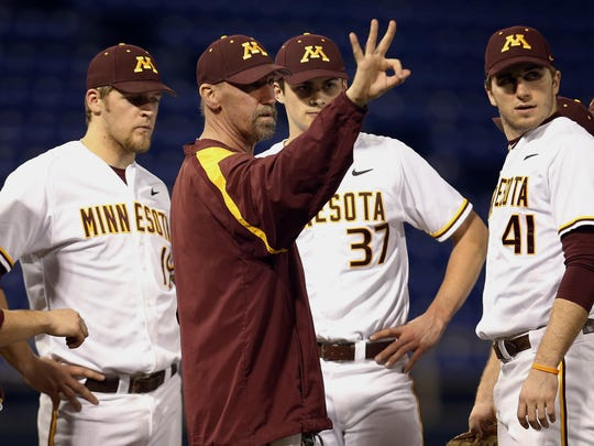 Minnesota Gophers pitching coach Todd Oakes calls for a new pitcher in the sixth inning of an NCAA baseball game on Feb. 27, 2013, in Minneapolis.