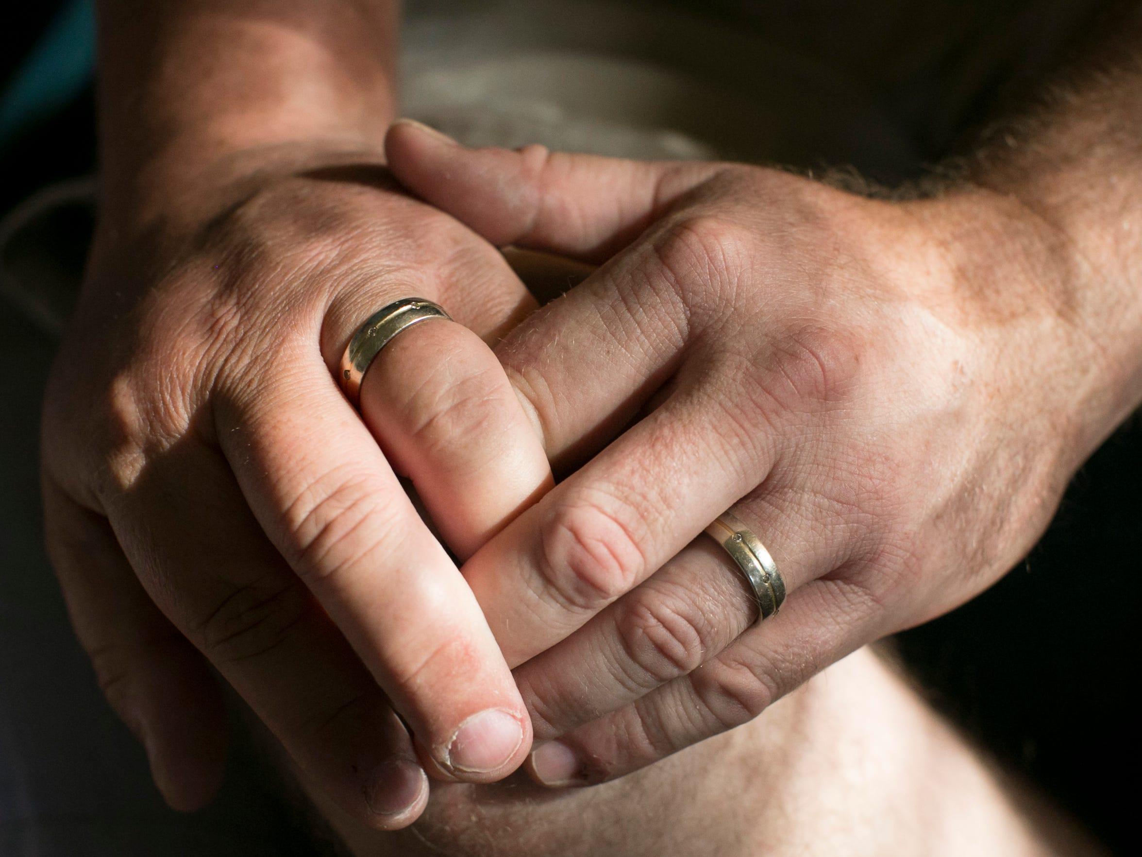 Arizona Same Sex Marriage Suit hands