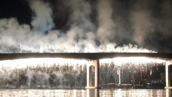 Waterfall fireworks off the Manette Bridge Saturday night.