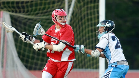 Suffern Ryan DaCosta (24) guards North Rockland's Steven Apicella (21) defense during boys lacrosse game at Suffern Middle School on May 8, 2018. Suffern defeats North Rockland 21-13.