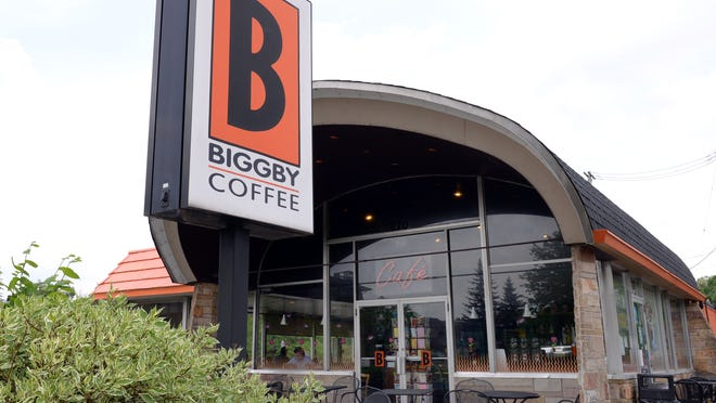 The orignal Biggby Coffee store located on Grand River Avenue in East Lansing. The building was formerly an Arby's fast food restaurant and a bus station and has a signature sloped roof.