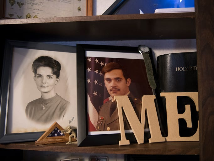 Leasher keeps a shelf of mementos that belonged to