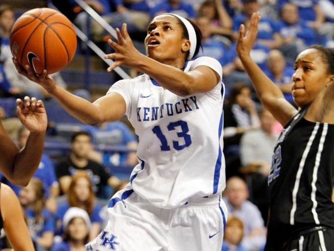 Kentucky's Bria Goss (13) shoots next to Duke's Haley Peters during the first half of an NCAA college basketball game, Sunday, Dec. 22, 2013, in Lexington, Ky. (AP Photo/James Crisp)