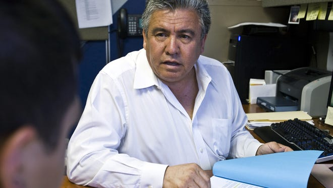 Elias Bermudez, seen here in this 2010 file photo, is accused of advising taxpayers to claim unqualified dependents to gain tax-credit deductions.