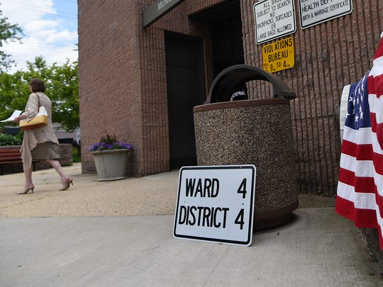 Primary voting in held at the Englewood Municipal Court building on Tuesday June, 05, 2018. A woman leaves the municipal court building, where residents can vote.