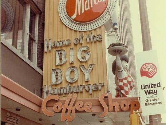 The statue hoisting a burger was a familiar sight outside