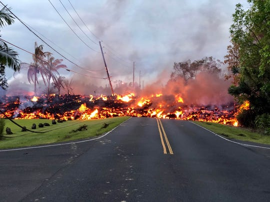 Lava covers a street in the Leilani Estates neighborhood on May 6, 2018, on Hawaii''s Big Island