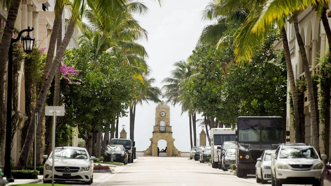 Businesses along Worth Avenue in Palm Beach reopened Monday after all pedestrian and vehicle traffic had been closed since Friday because of the threat of demonstrations over the police-custody death of George Floyd.