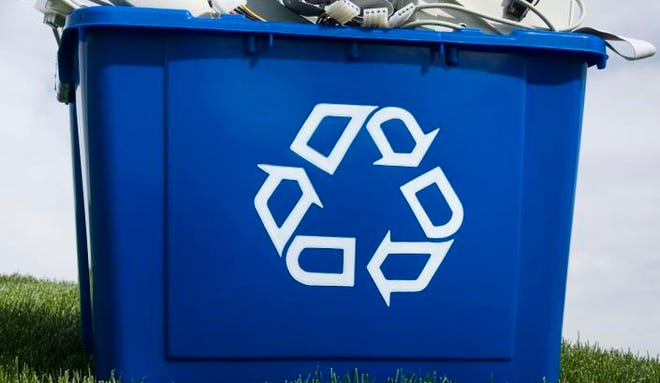 Stock photo of Recycling container with electronic items.