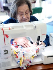 Marilyn Butler sews hats for surgical patients of Golisano