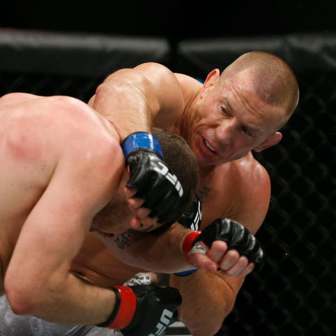 Coach of Georges St-Pierre wants UFC legend to pursue boxing match with Floyd Mayweather