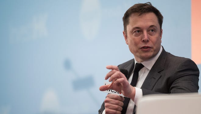 Elon Musk, who leads both SpaceX and Tesla Motors, speaks at a conference in China on January 26, 2016.