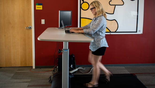 Laurie Street, People Team Project Manager at Motley Fool, uses a treadmill desk May, 20, 2015 in Alexandria, VA.