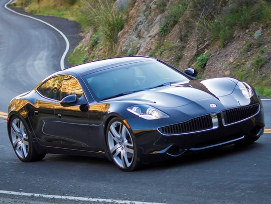 The 2011 Fisker Karma, Henrik Fisker's first automotive venture, was a dramatic plug-in hybrid. But battery and financial problems eventually caused the company to go bankrupt. It has been revived by a Chinese company.