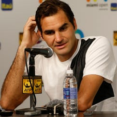 Roger Federer is keeping his Wimbledon expectations muted.