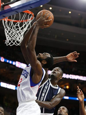 The 76ers' Luc Richard Mbah a Moute puts up a shot with the Thunder's Anthony Morrow defending during the first half Friday in Philadelphia.