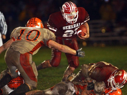 Sheridan's Brian Crader tries to elude the New Lexington defense during a 2008 game in suburban Thornville. Crader had three interceptions in the game, which the top-ranked Generals won, 7-0. New Lexington was state-ranked in Division IV.