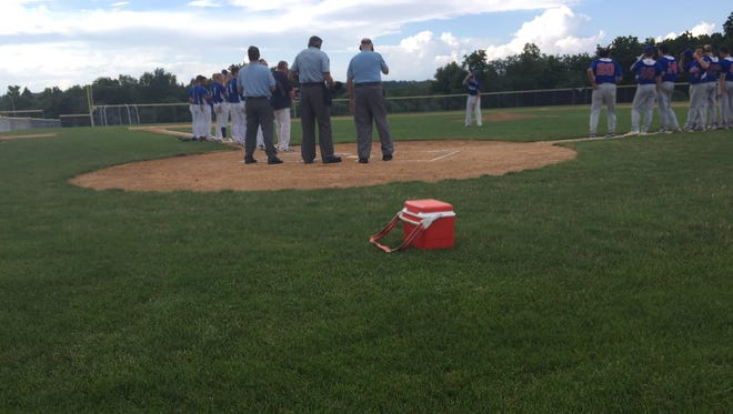 Players, coaches and umpires  stand on the field as the Legion Baseball Code of Sportsmanship is recited prior to Saturday's playoff game between Annville and Campbelltown at Annville-Cleona High School. Annville won, 5-0.