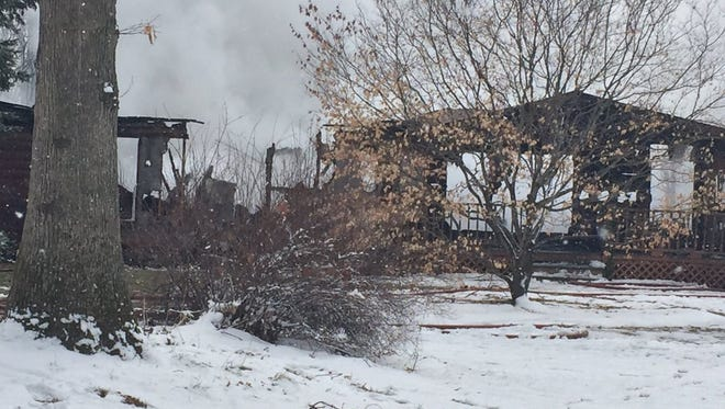 The fire destroyed the home, at least one dog and an unknown number of other pets perished.