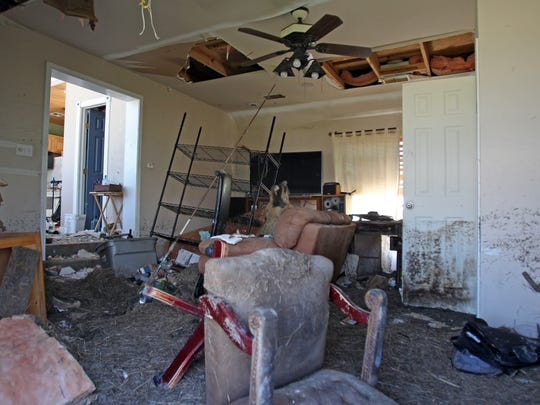 This is the living room of Scott McCune's former Rockport home near Port Bay. Notice the water line on the wall.