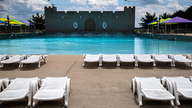 Deck chairs are set up and ready for groups of patrons to keep them separated at the front of the wave pool at Knights Action Park, Tuesday, June 23, 2020, in Springfield, Ill. Knights Action Park plans to open at 10:30 a.m. on Friday with admission at 50 percent capacity as Illinois moves into Phase 4 during the COVID-19 pandemic.