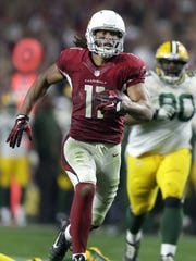 Arizona Cardinals receiver Larry Fitzgerald breaks away for a 75-yard catch-and-run to set up the game-winning score in overtime during an NFC divisional round playoff game in January.
