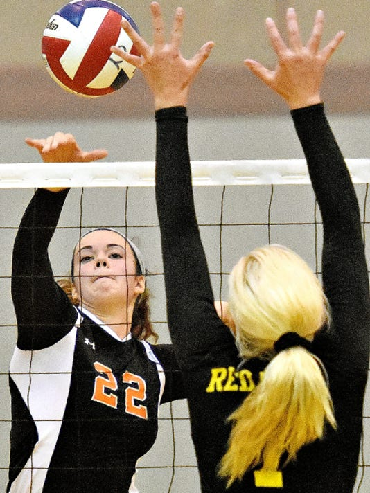 Central York's Emily Poole, left, hits the ball across the net while Red Lion's Lindsey Blevins, right, defends, during girls' volleyball action earlier this season. Both Poole and Blevins were All-District 3-AAA first-team selections.