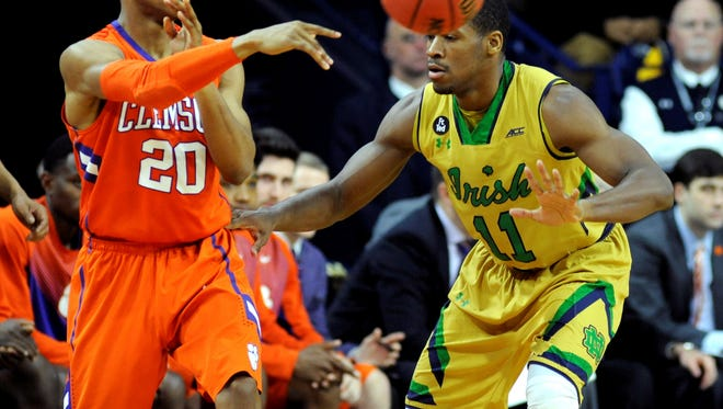 Clemson guard Jordan Roper (20) throws a pass around Notre Dame guard Demetrius Jackson (11) during second half action in an NCAA college basketball game Saturday, March 7, 2015, in South Bend, Ind. (AP Photo/Joe Raymond)