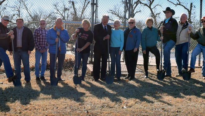 The Camp Fire Pool Planning Committee held a groundbreaking for the new swimming pool at Harrell Park Friday. From left, Bill Presson, Matt English, Nick Bratcher, Mac Cannedy, Susanne Hogue, Bob Hampton, Bettye Ricks, Glenda Ramsey, Martha Hall, Jerry Taylor, Paul Foley and Jimmy Anderson.